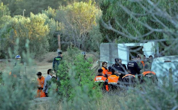 Detenida la madre de dos niños hallados muertos y enterrados en Valencia